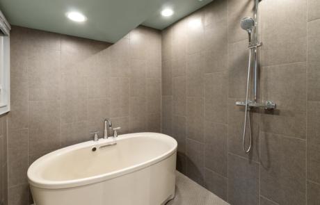 Bathroom Remodeling, Kohler soaking bathtub, shower room, no threshold shower stall, quartz countertops, tile, contemporary vanity